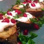 roasted eggplants with thyme, garlic yogurt sauce, and pomegranate arils