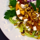 mediterranean zoodle salad with tomatoes, feta, and pine nuts