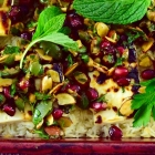 colorful baked rice with mint, feta and pomegranate
