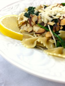 spinach lemon pasta with toasted almonds closeup :: by radish*rose