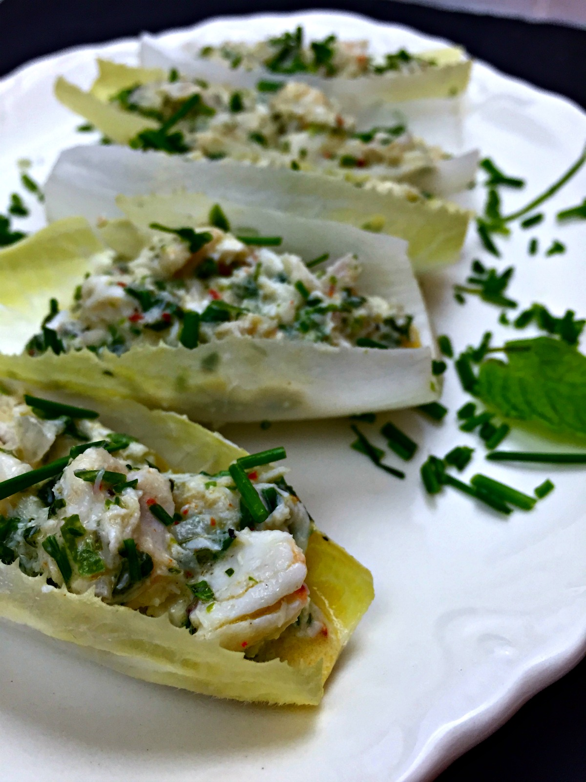 crab salad with lime, mint, and chives on endive :: by radish*rose